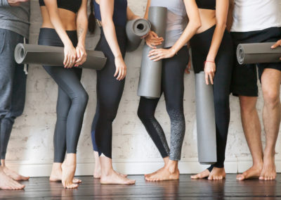 Group of young fitness people. Legs close up view